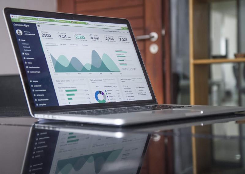 Open laptop displaying financial data